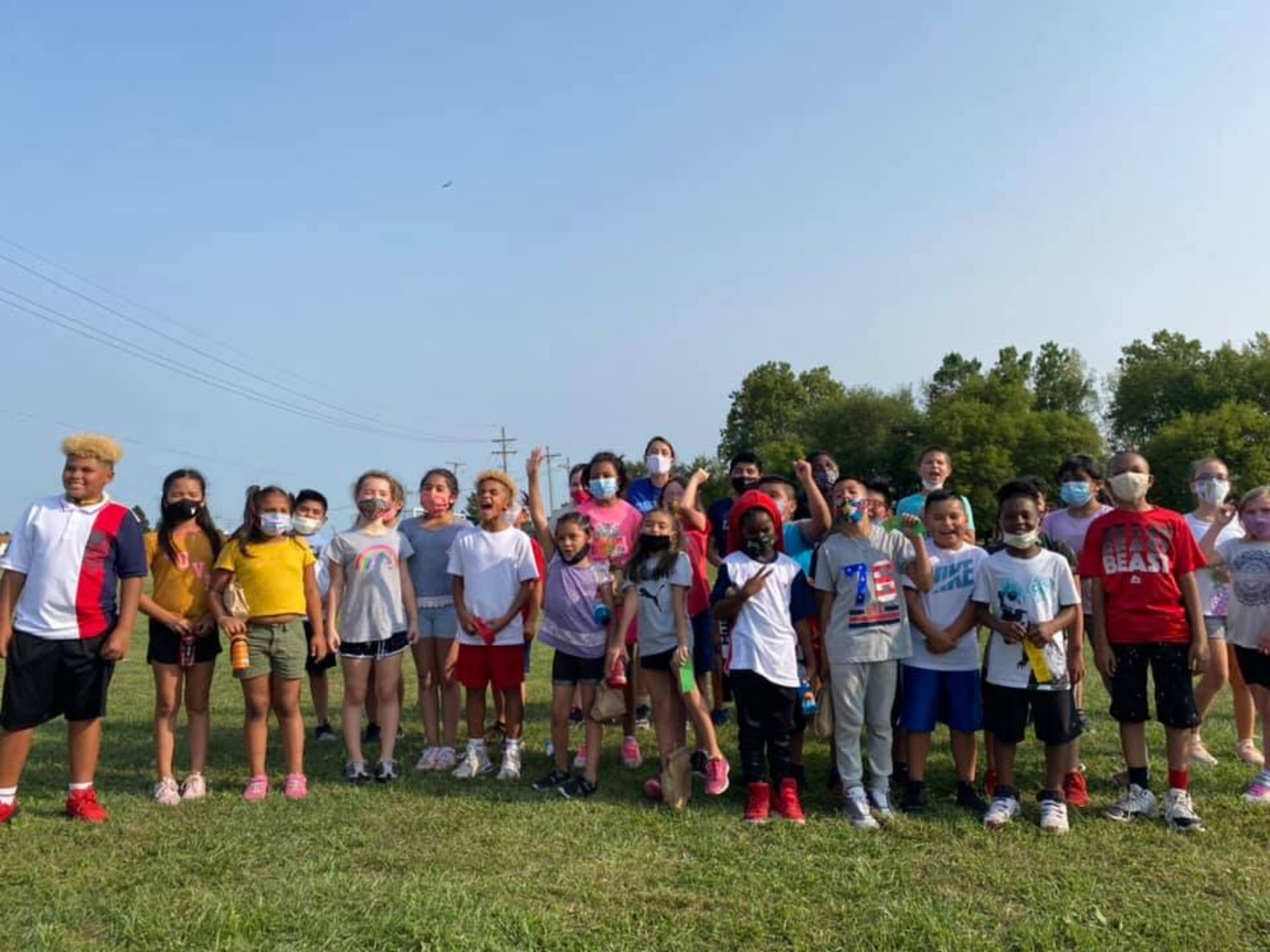 Students pose following cross country meet