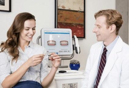 Doctor Guiding Patient Regarding Teeth