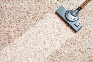 Carpet cleaning by vacuum