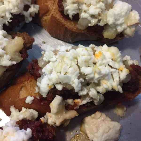 Crostini with Spicy Soy Chorizo, Caramelized Pears & Goat Cheese