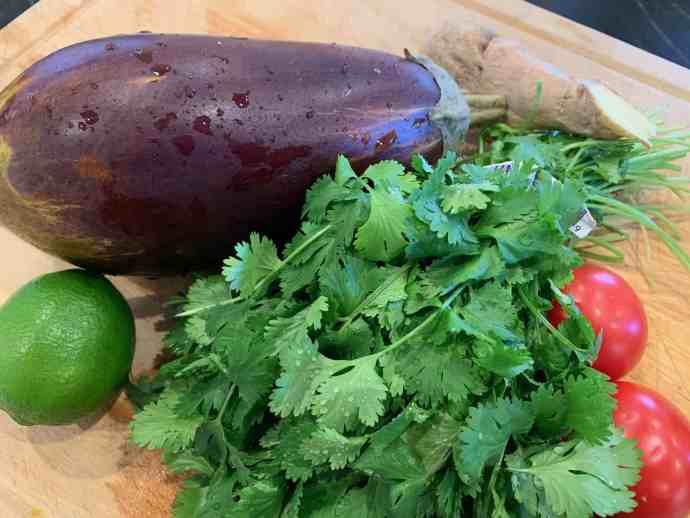 eggplant, cilantro, tomatoes, ginger, lime