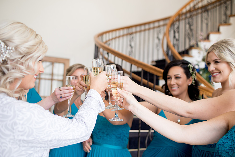 bridesmaids and bride have a champagne toast