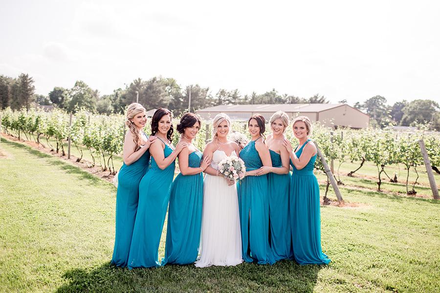 bride with her bridesmaids in aqua floor length dresses