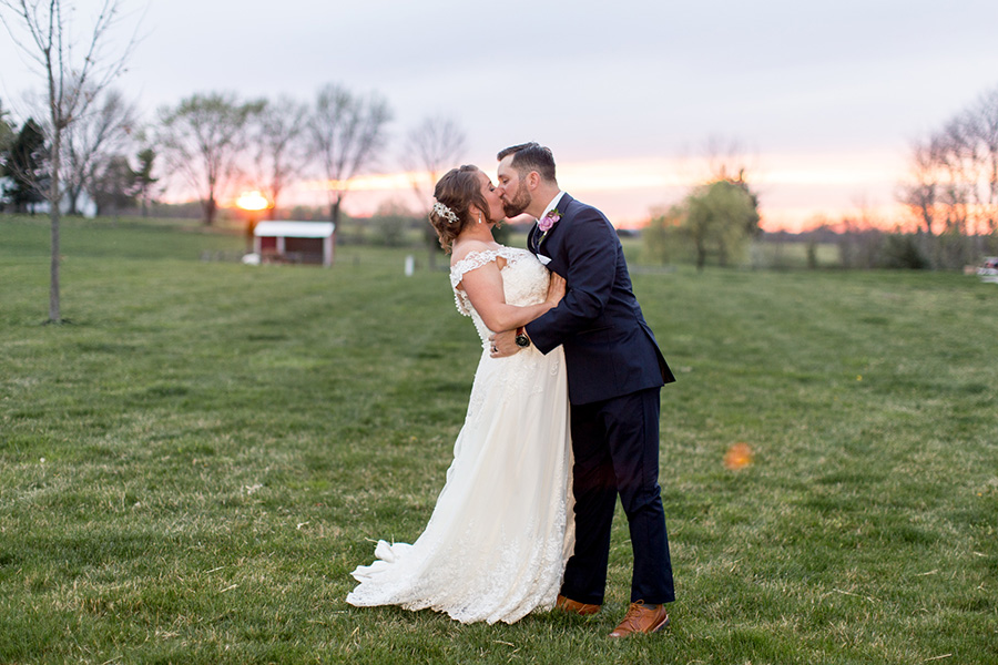 bride and groom pose for sunset wedding portraits at Warner Road Farm
