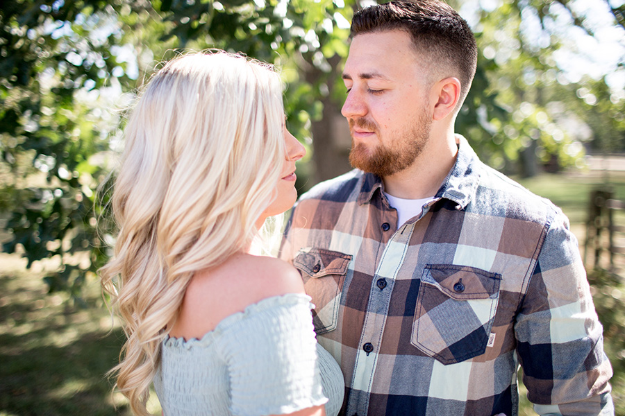 mint and plaid wardrobe choice for engagement pictures