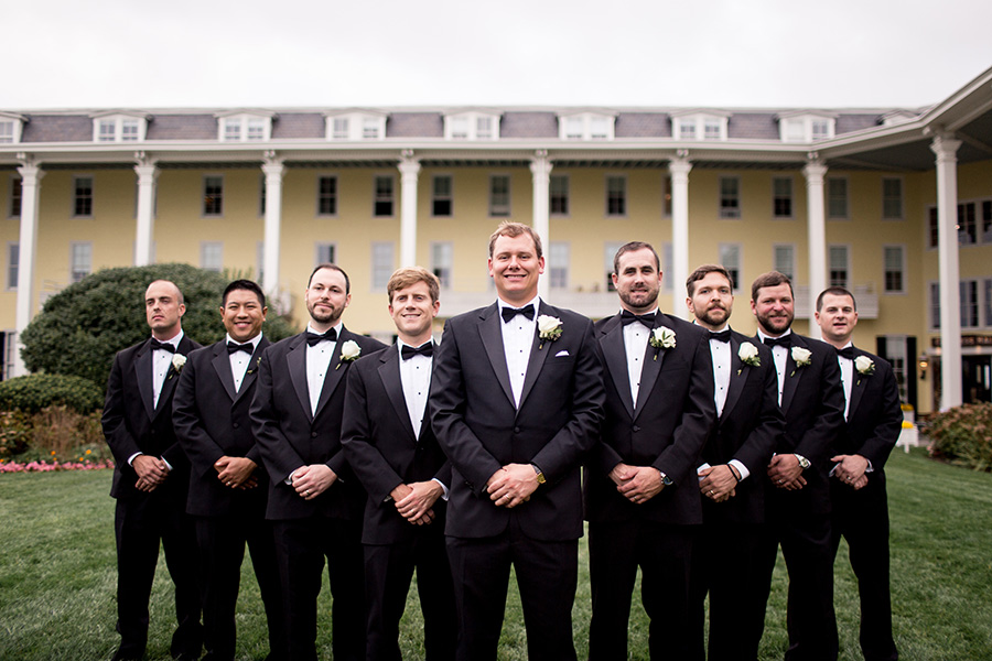 groomsmen in black tuxes at congress hall