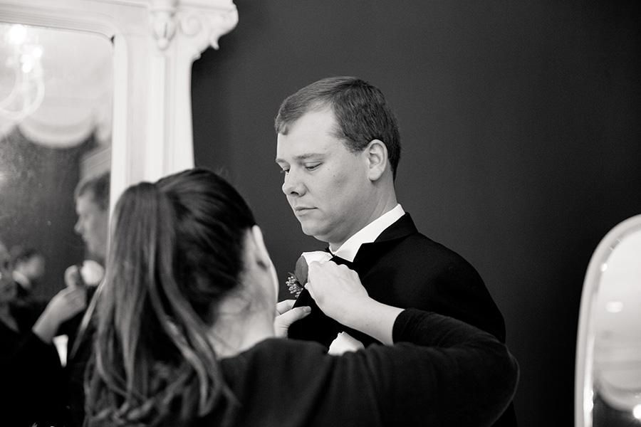 groom gets his flower pinned on