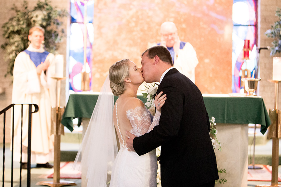bride and groom share their first kiss in cape may catholic ceremony