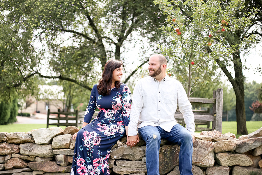 couple in apple orchard at ironstone ranch
