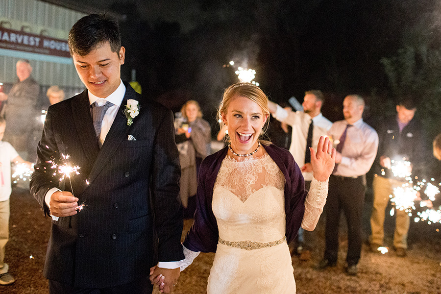 bride and groom have a grand exit with sparklers outside Hill Creek Farms
