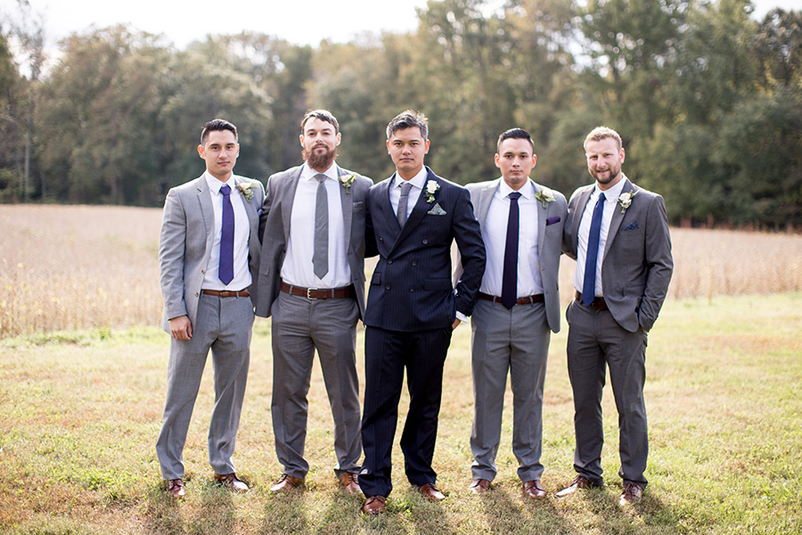 groomsmen with groom at the farm before the wedding ceremony
