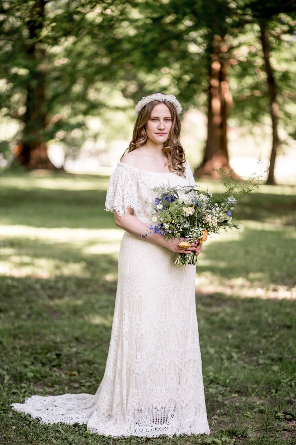 bohemian bride with her wildflower bouquet