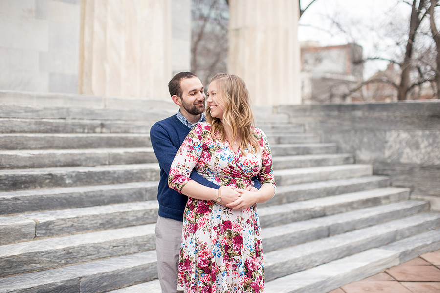 couple poses for their society hill engagement