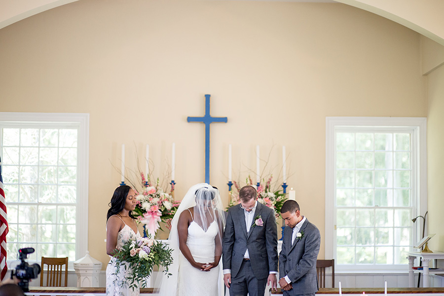 prayer at the end of the wedding ceremony in allaire chapel