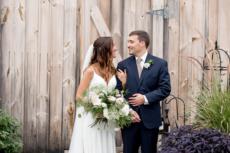 bride and groom smile at each other after wedding ceremony