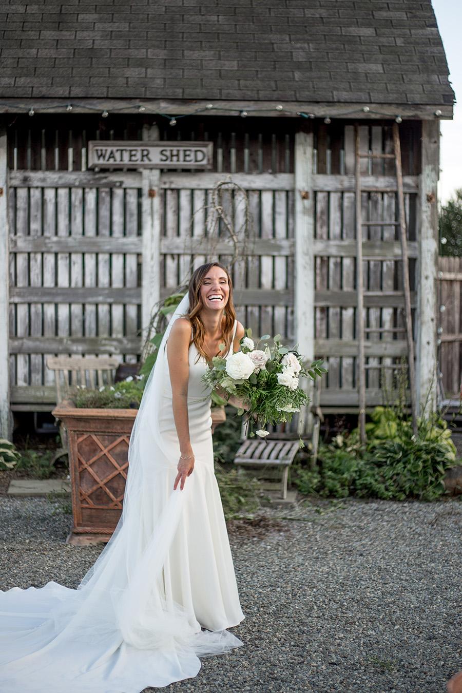 bride poses at bast brothers wedding venue