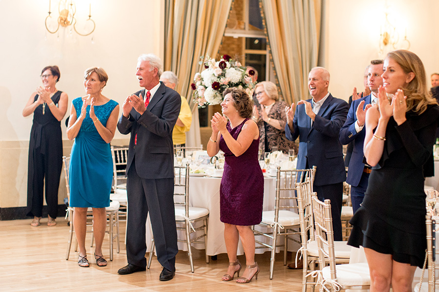 guests cheer for the married couple at the reception