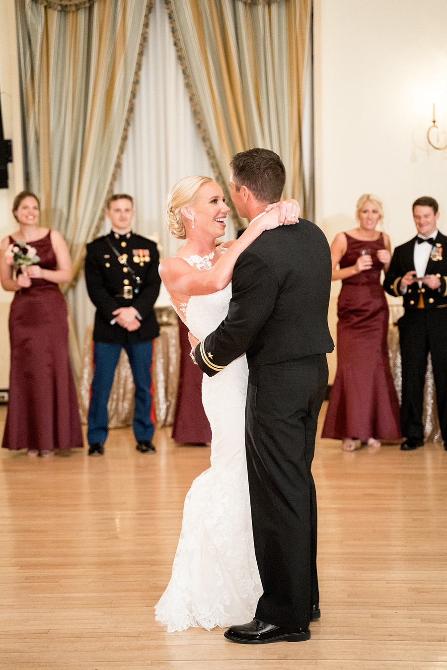 bride and groom share first dance in the ballroom at dupont country club
