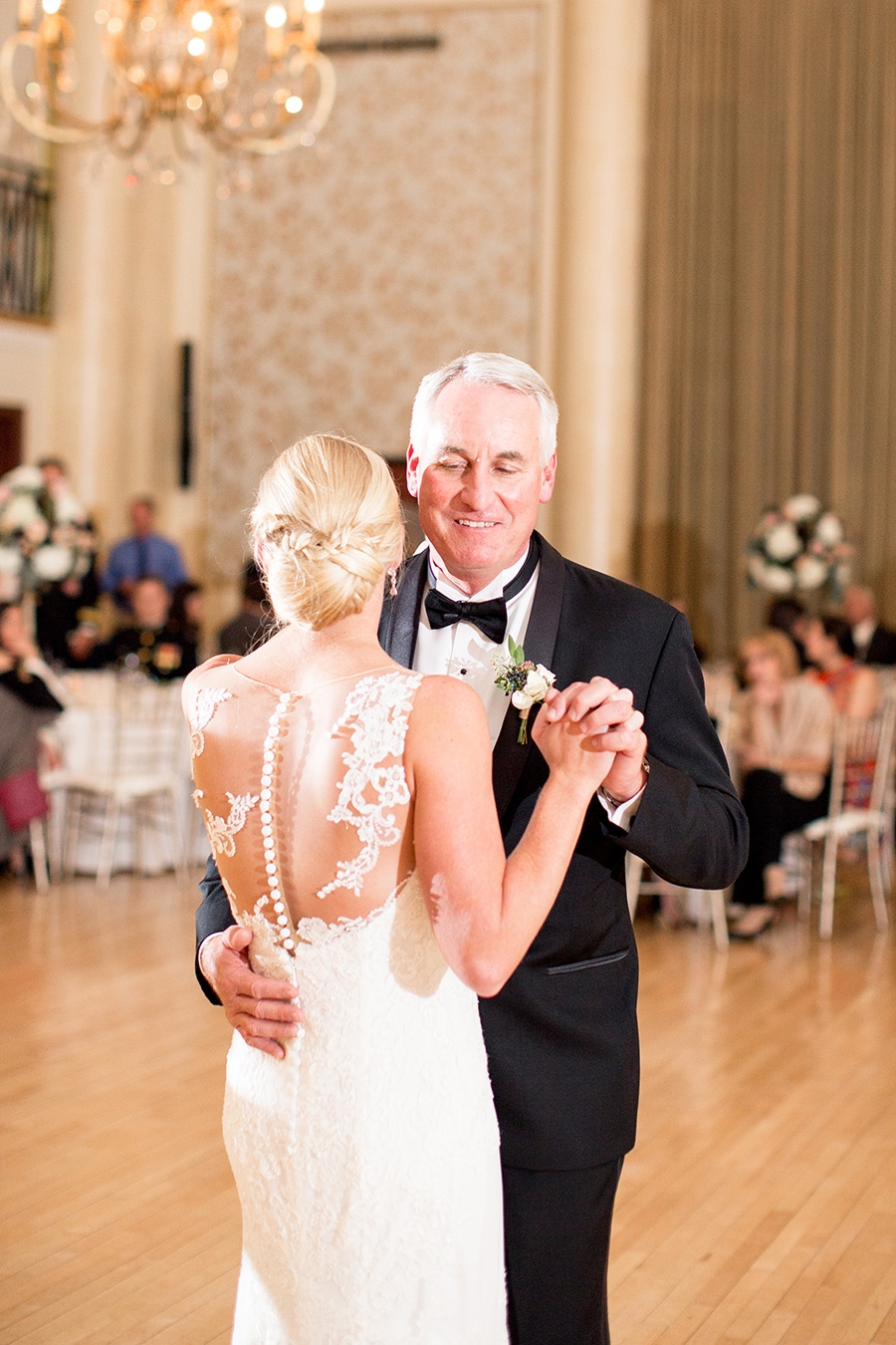 dupont country club wedding where bride dances with her dad in the ballroom