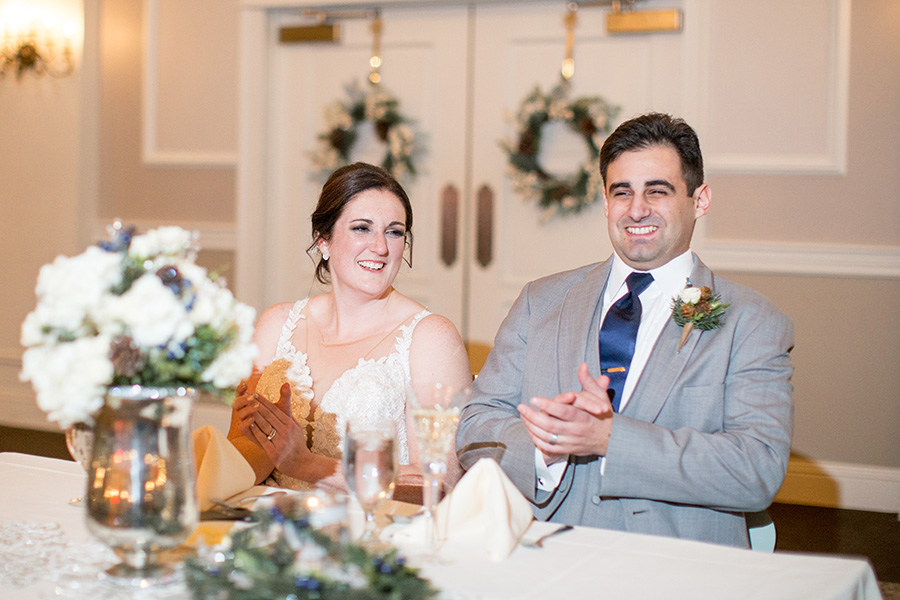 bride and groom listens to wedding toasts at eastlyn golf course