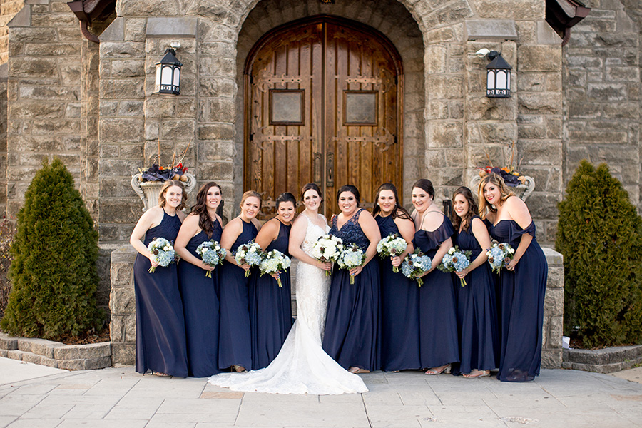 bridesmaids dressed in navy and carrying winter bouquets for eastlyn golf course wedding
