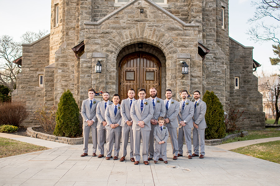 groomsmen together outside immaculate conception church