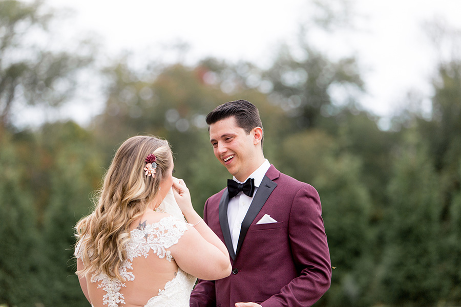 groom gets emotion at first look