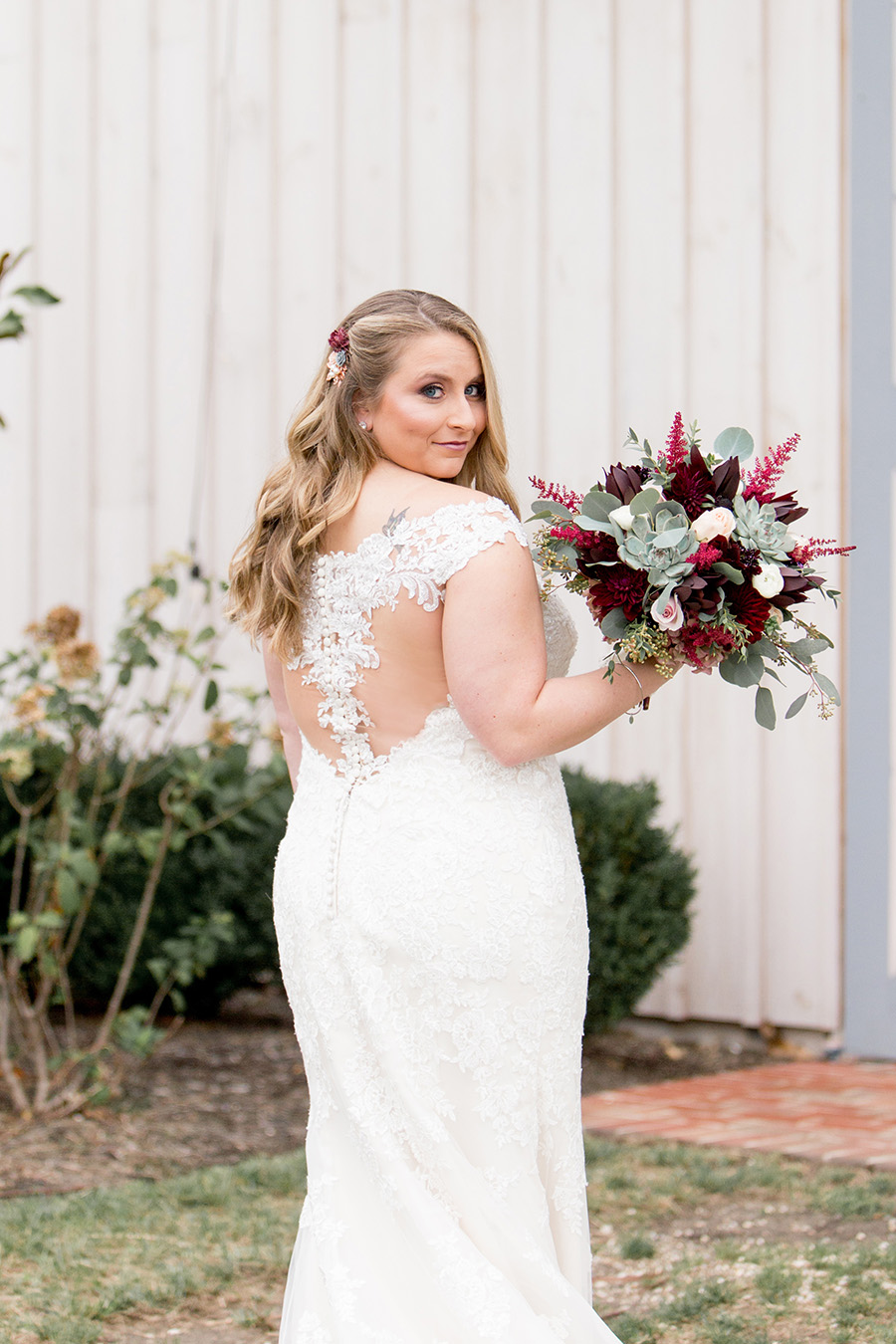 bride wearing lacey dress and waterfall curls