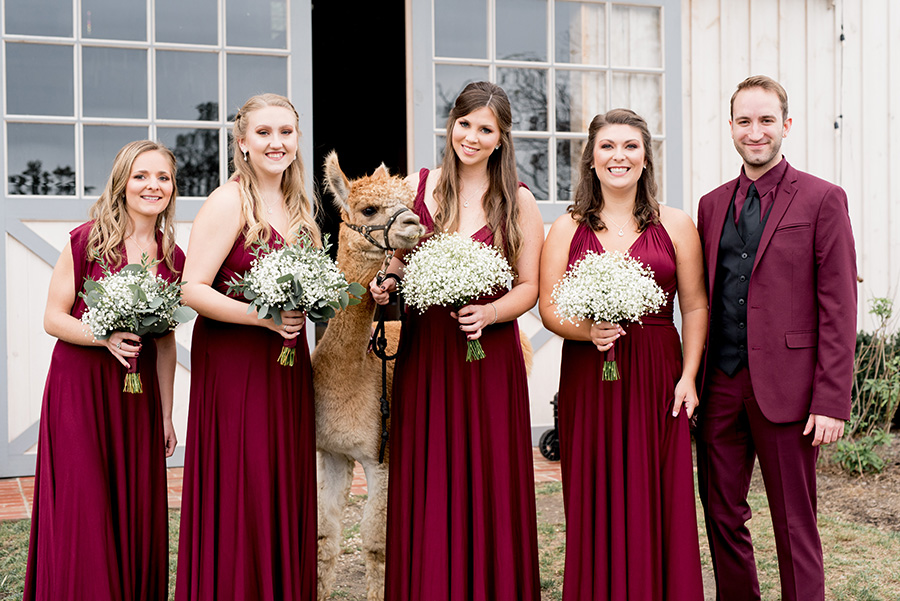bridesmaids dressed in floor length burgundy gowns