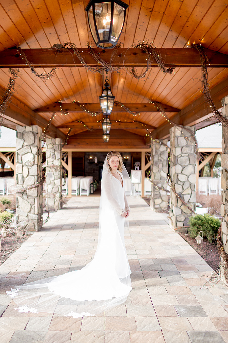 bride stands outside ceremony space at lawnhaven venue