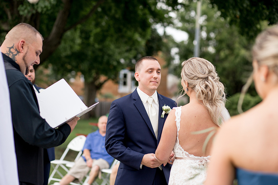 groom says his vows in front of wedding guests