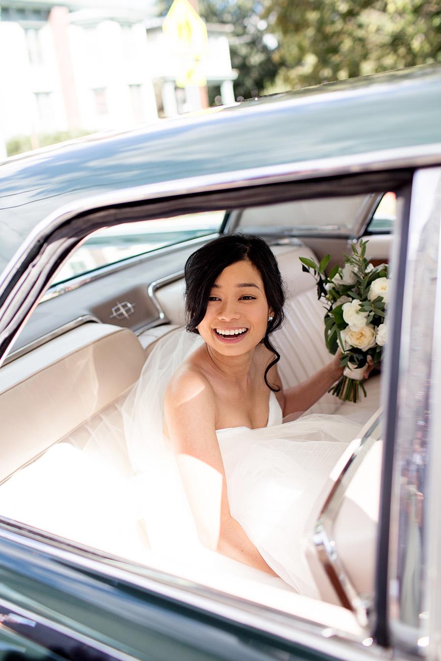 vintage getaway car for their wedding day