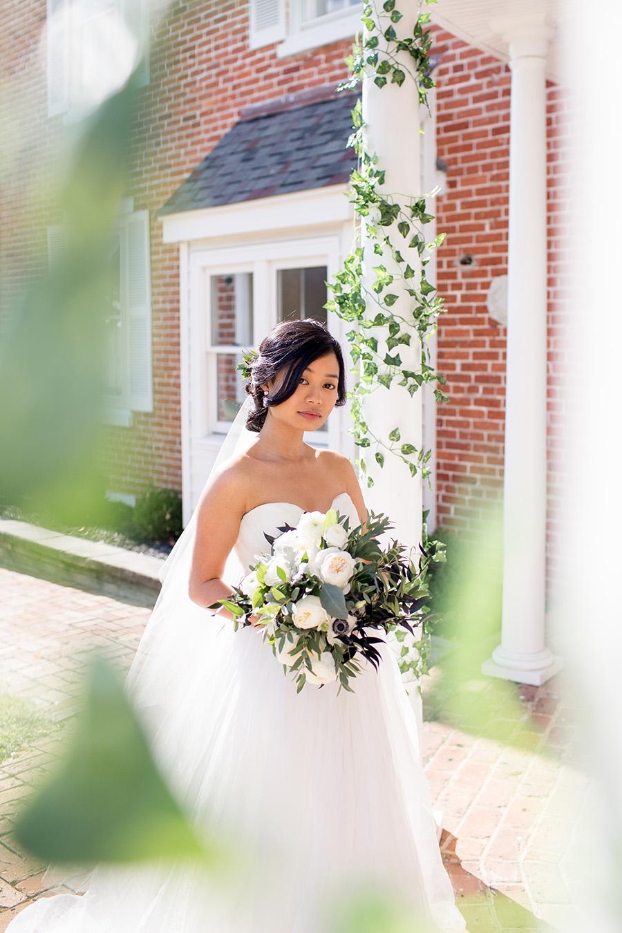bride on the porch of eagle manor