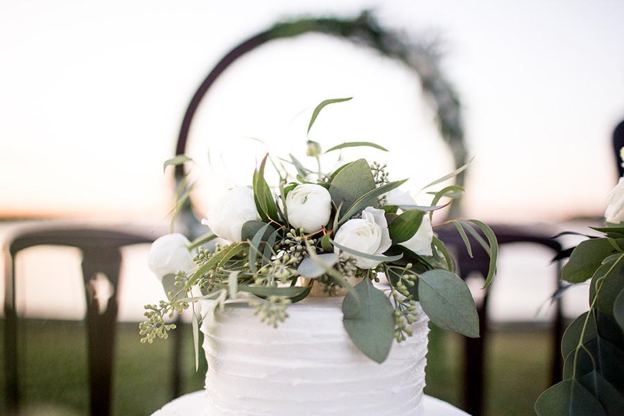 elegant white cake with greenery