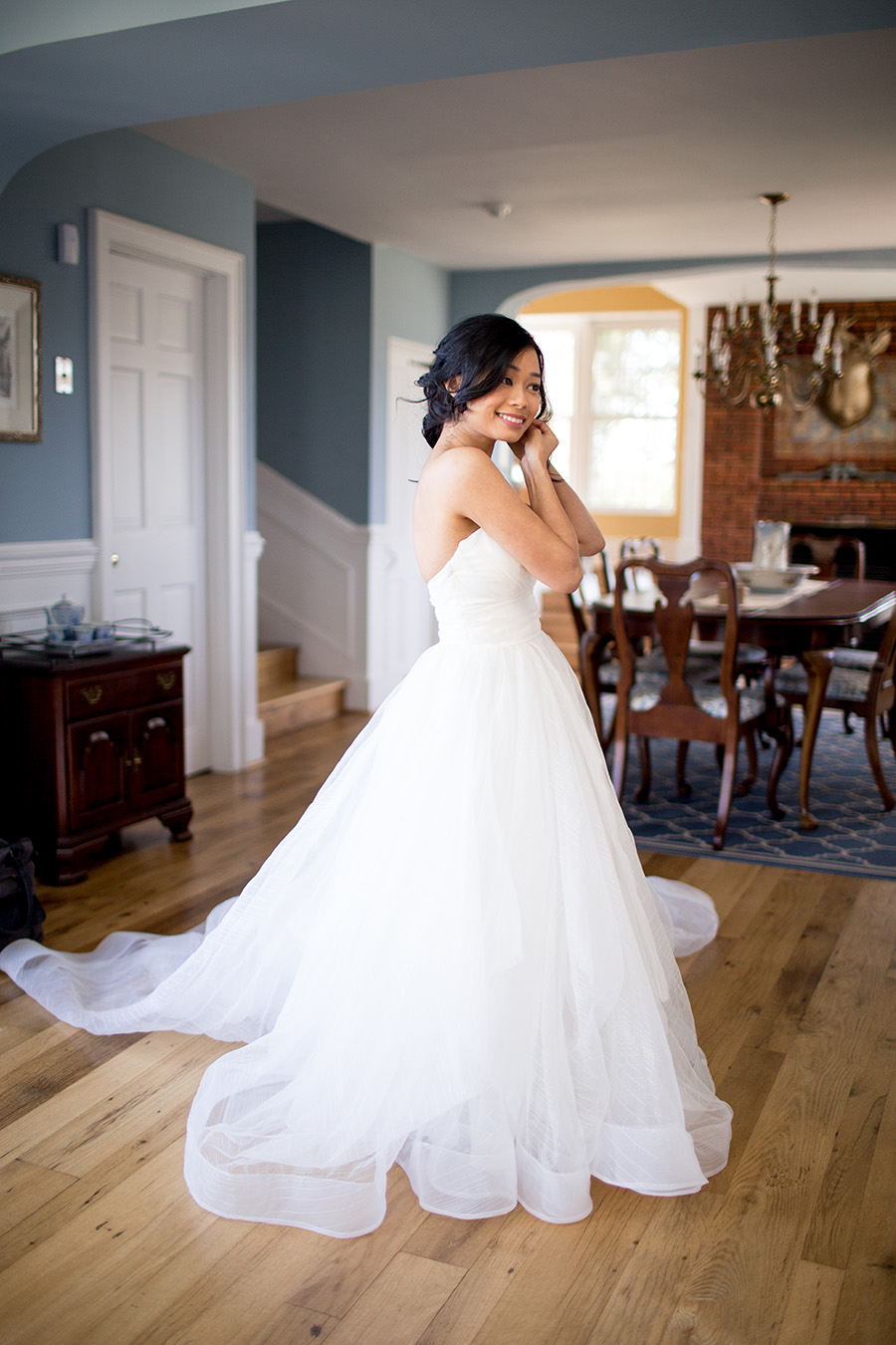 bride puts on her earrings at eagle manor