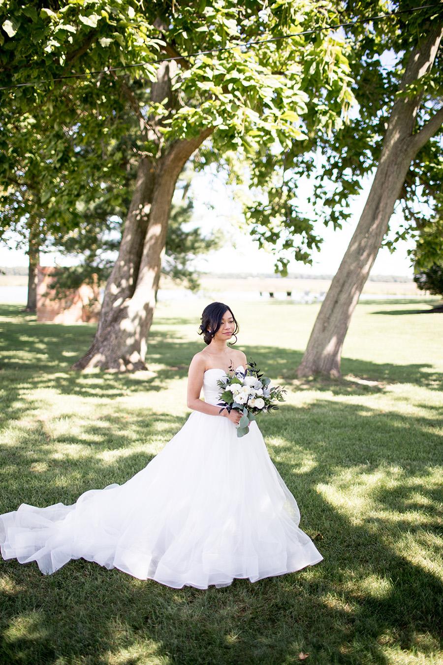bride looking at her groom in her wedding gown