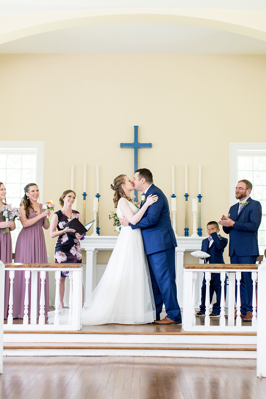 wedding ceremony in chapel at allaire state park