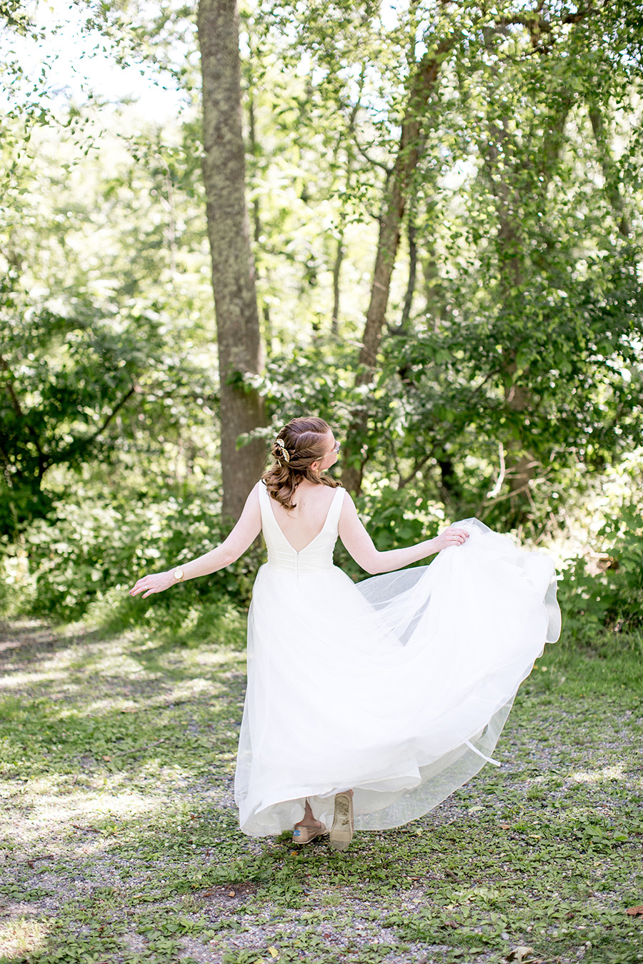 bride in her wedding dress at allaire state park