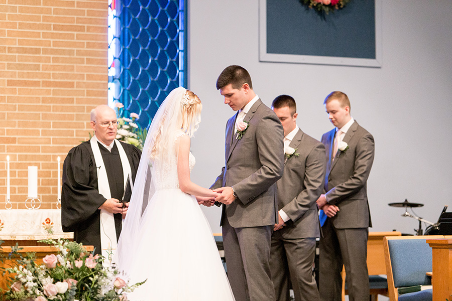 wedding party prays before the ceremony