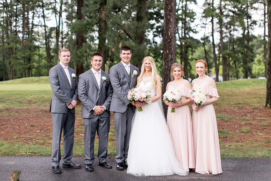 bridesmaids and groomsmen outside blue heron golf club