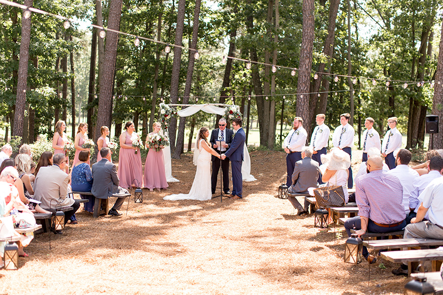 wedding ceremony outside at the timbers at running deer