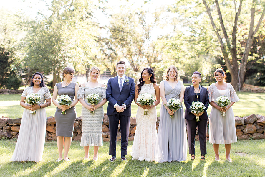 bride's tribe pose for portraits