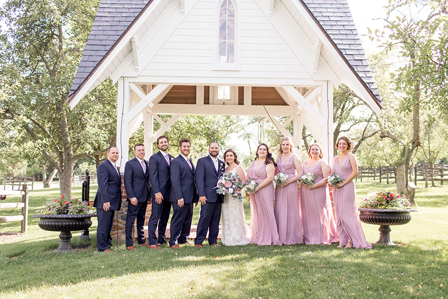Wedding party near the bell tower at ironstone ranch