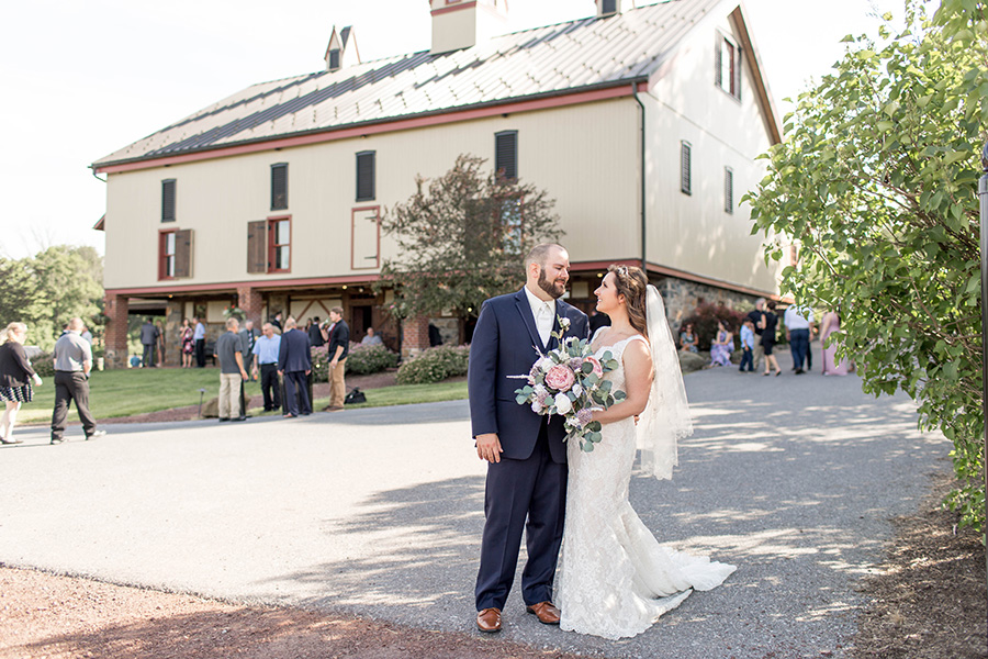 bride and groom in front of the barn at ironstone ranch