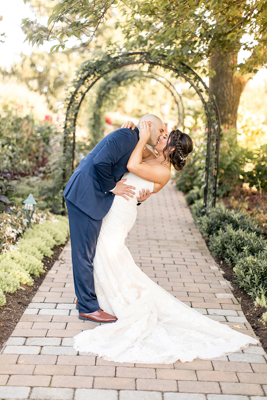 bride and groom give each other a kiss at penn oaks golf club