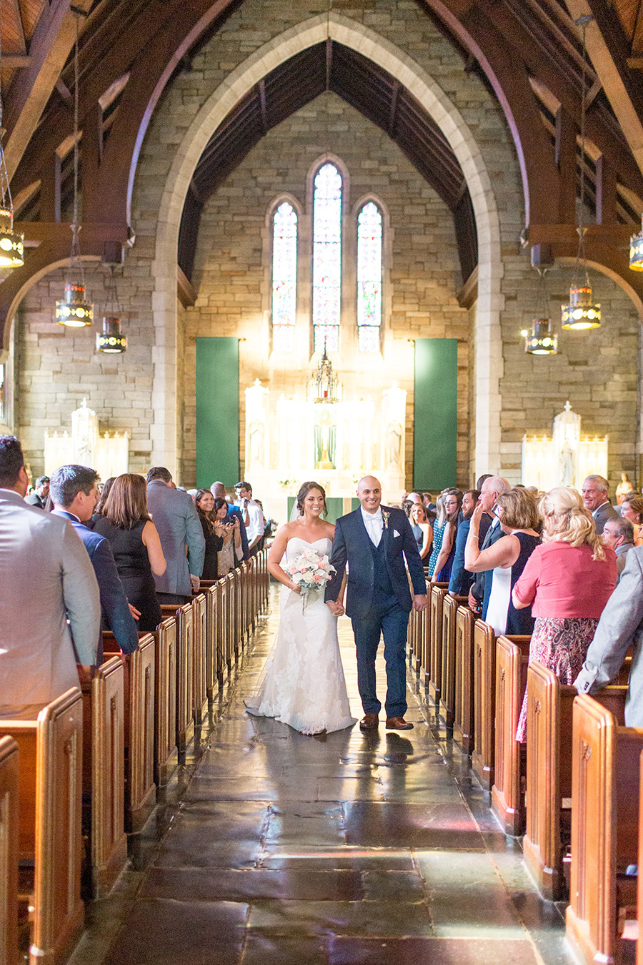 newly married couple at saint agnes church in west chester