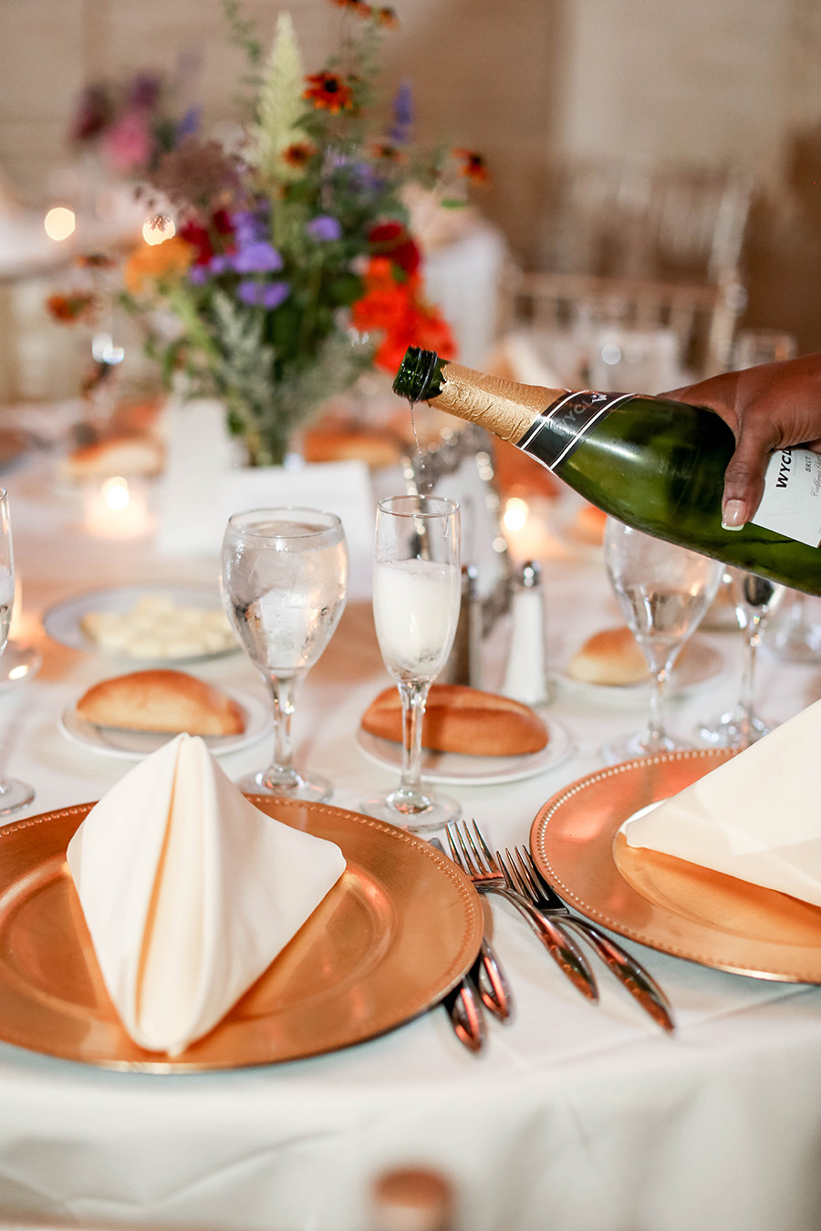 champagne being poured into flutes at union trust wedding
