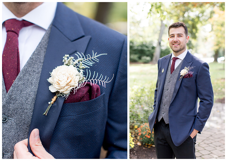 Groom's wooden flower boutonniere and maroon tie