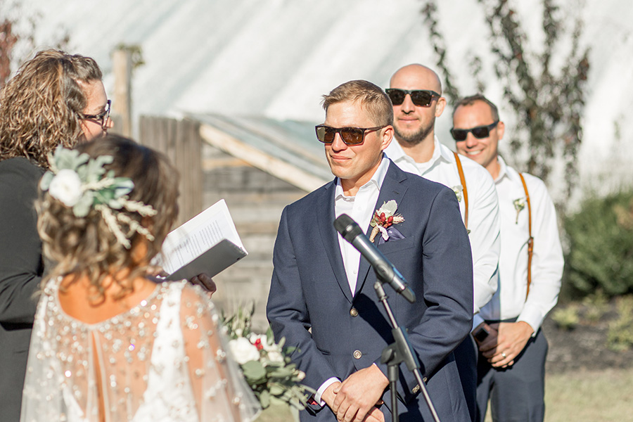Groom exchanges vows at wedding ceremony