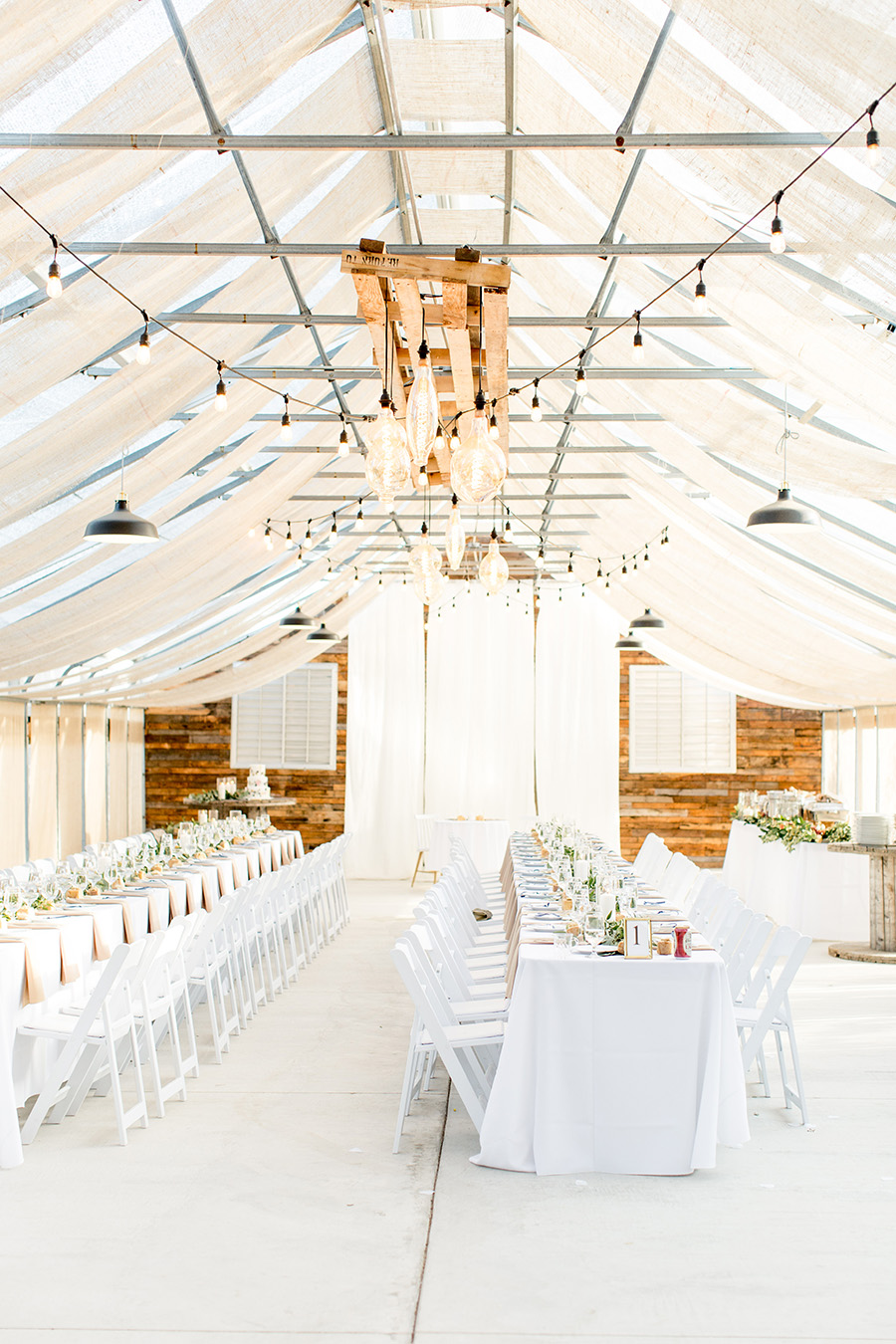 Minimalist wedding reception at Bast Brothers greenhouse